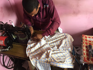 A local tailor working hard to make adjustments to my shirt