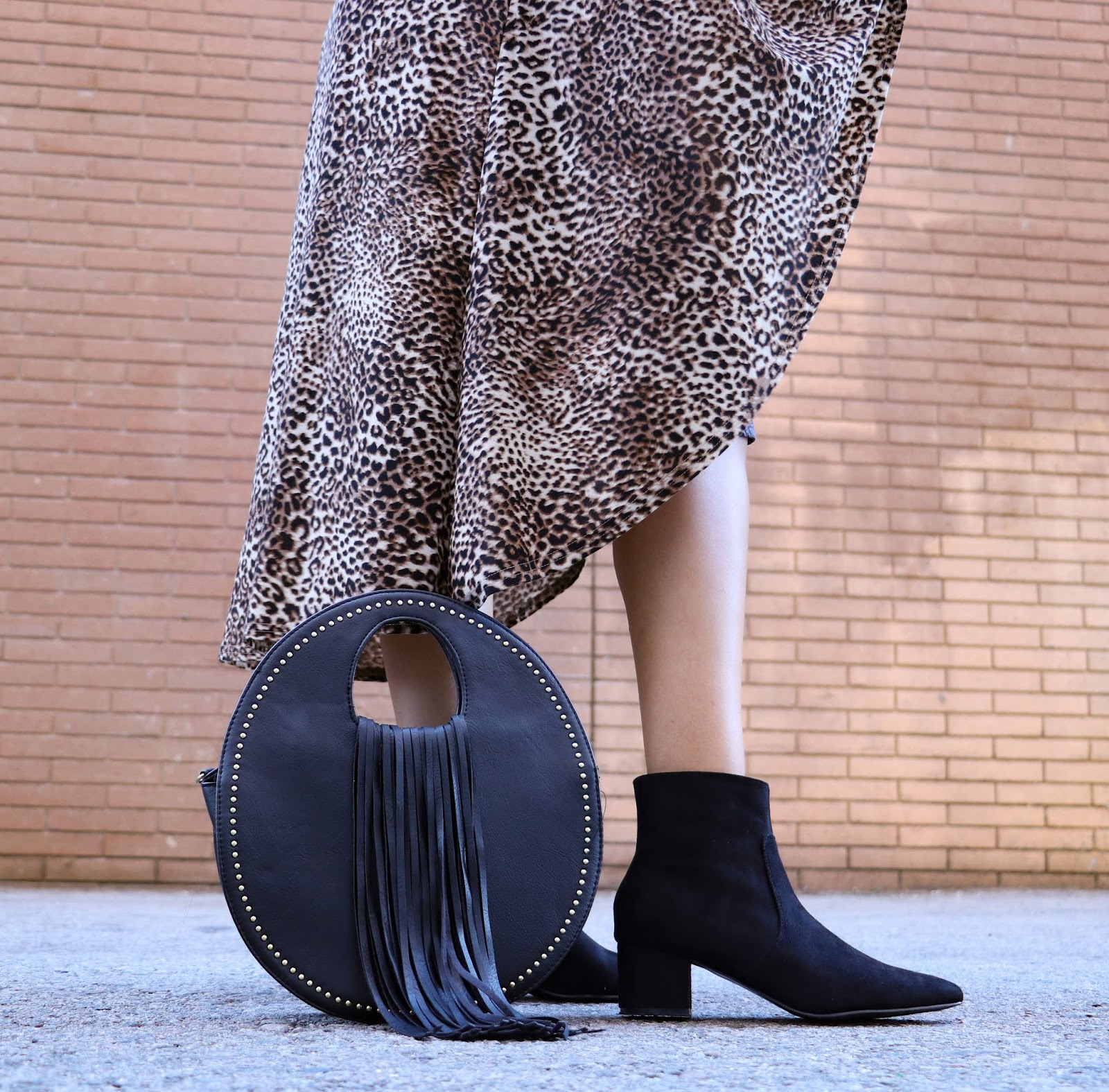 Leopard Duster, Black Round fringe purse with gold studs and black pointed Vegan suede boots