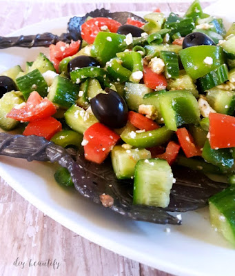 Looking for a simple and tasty salad that is packed full of veggies? This Greek Salad fits the bill. Get the recipe at diy beautify!