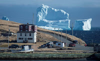 Residents view the first iceberg of the season as it passes the South Shore, also known as 'Iceberg Alley', near Ferryland Newfoundland, Canada April 16, 2017. (Credit: Reuters/Greg Locke/File Photo) Click to Enlarge.