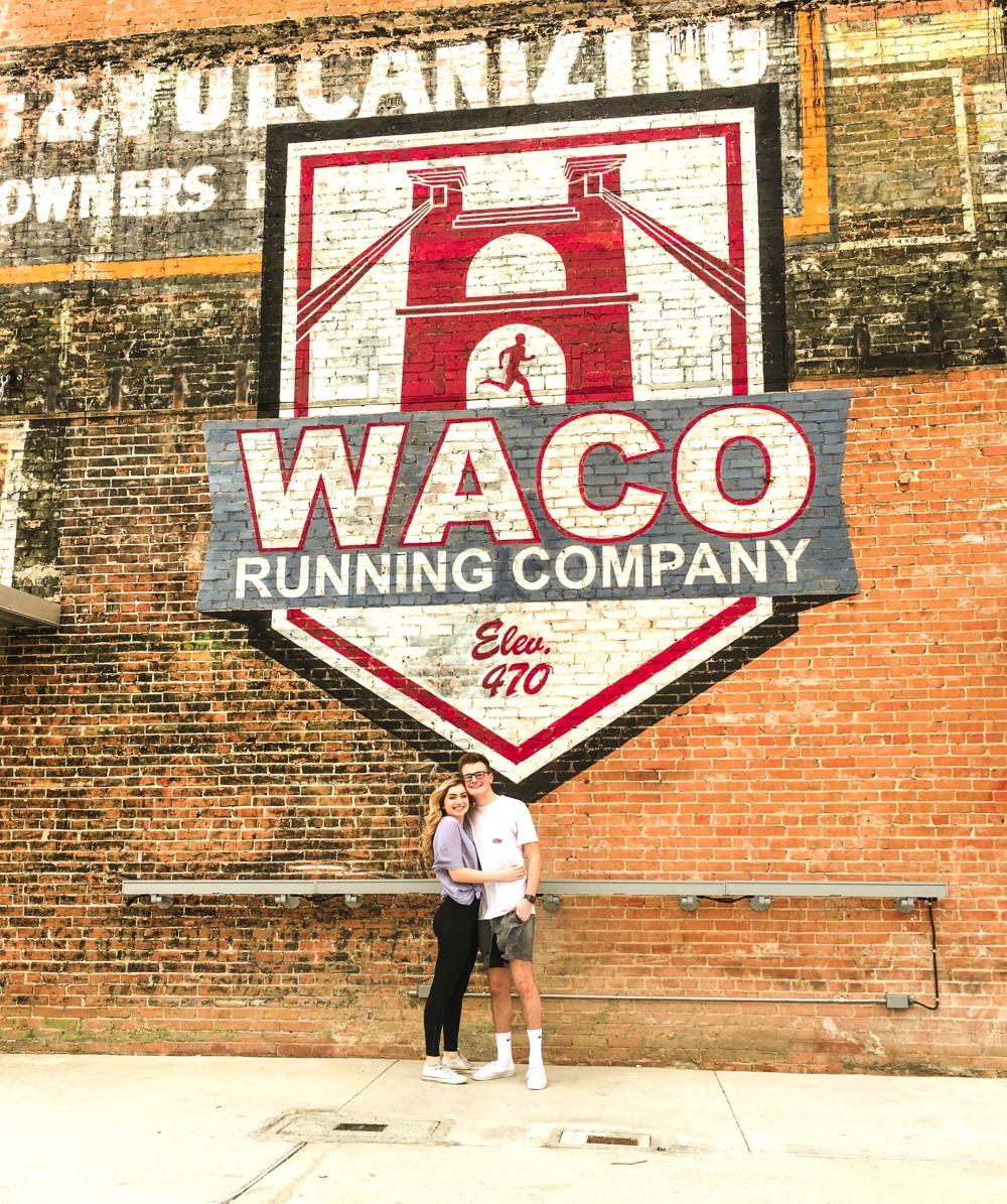 waco running company brick wall mural