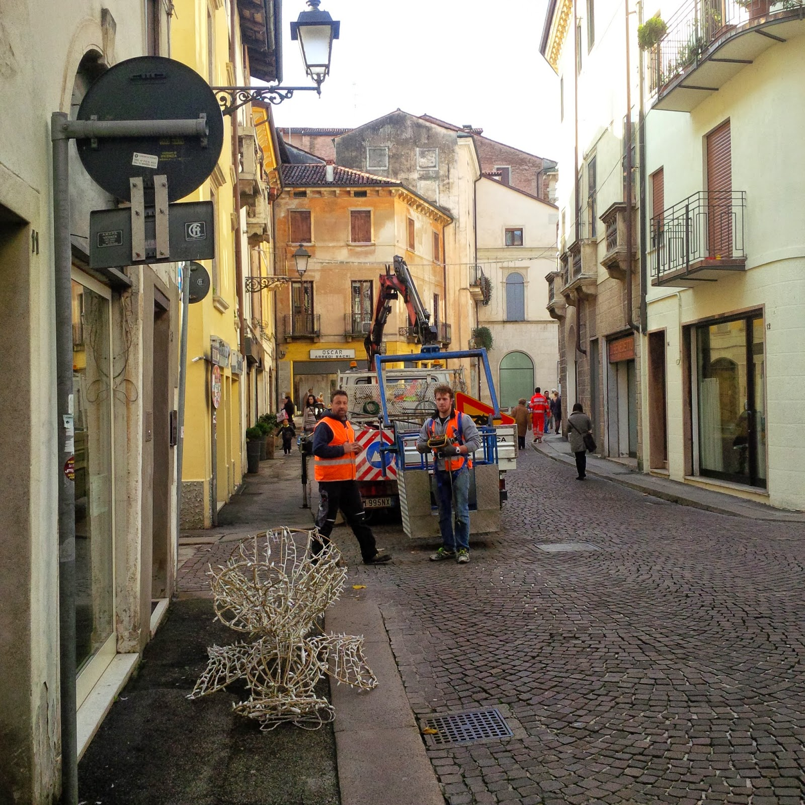 Workers hanging up Christmas lights around Vicenza