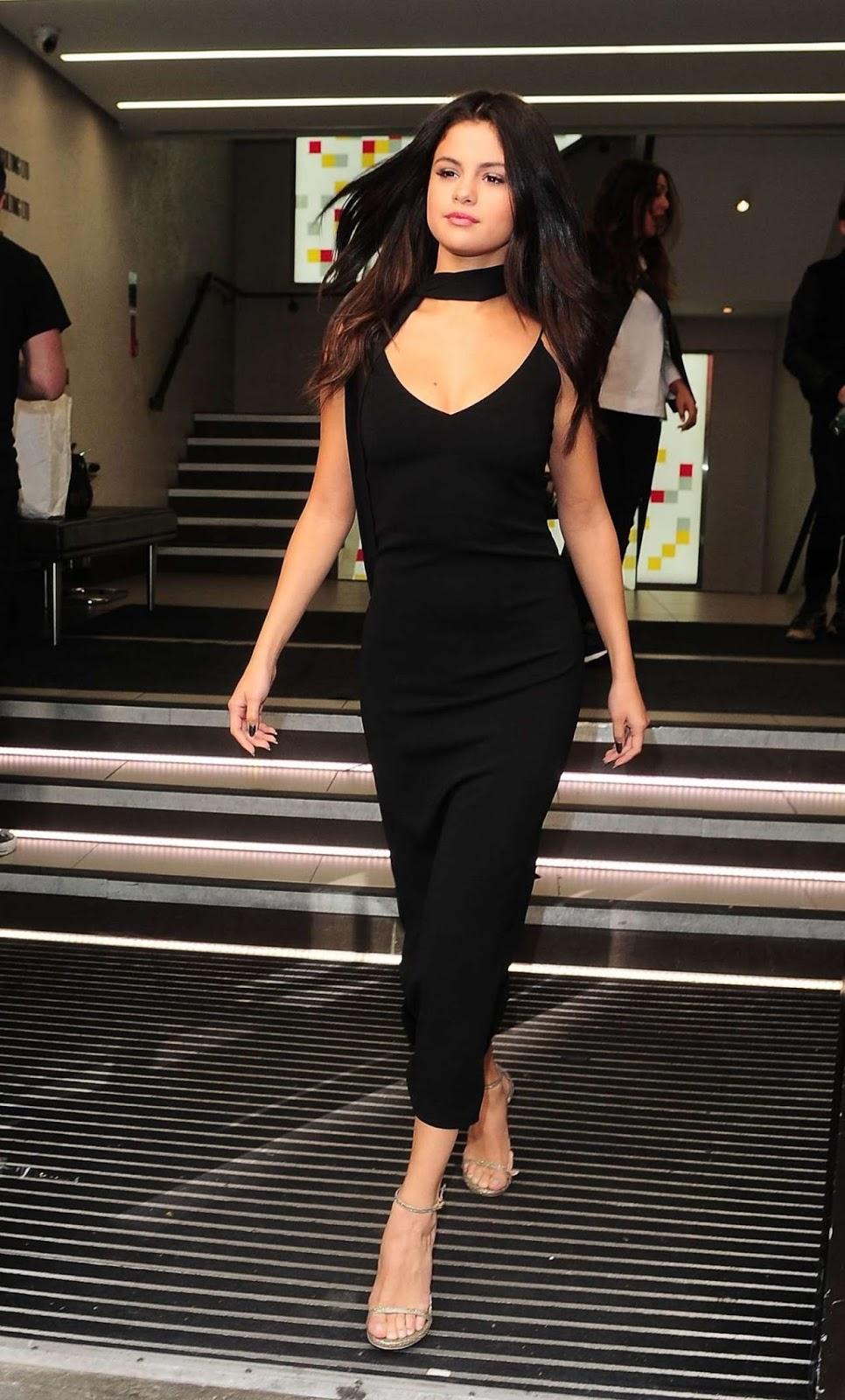 Selena Gomez struts in style in a black dress in London