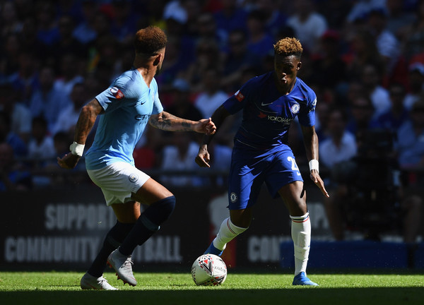 Callum Hudson-Odoi of Chelsea takes on Fernandinho of Manchester City (L) and Kyle Walker of Manchester City during the FA Community Shield between Manchester City and Chelsea at Wembley Stadium on August 5, 2018 in London, England.