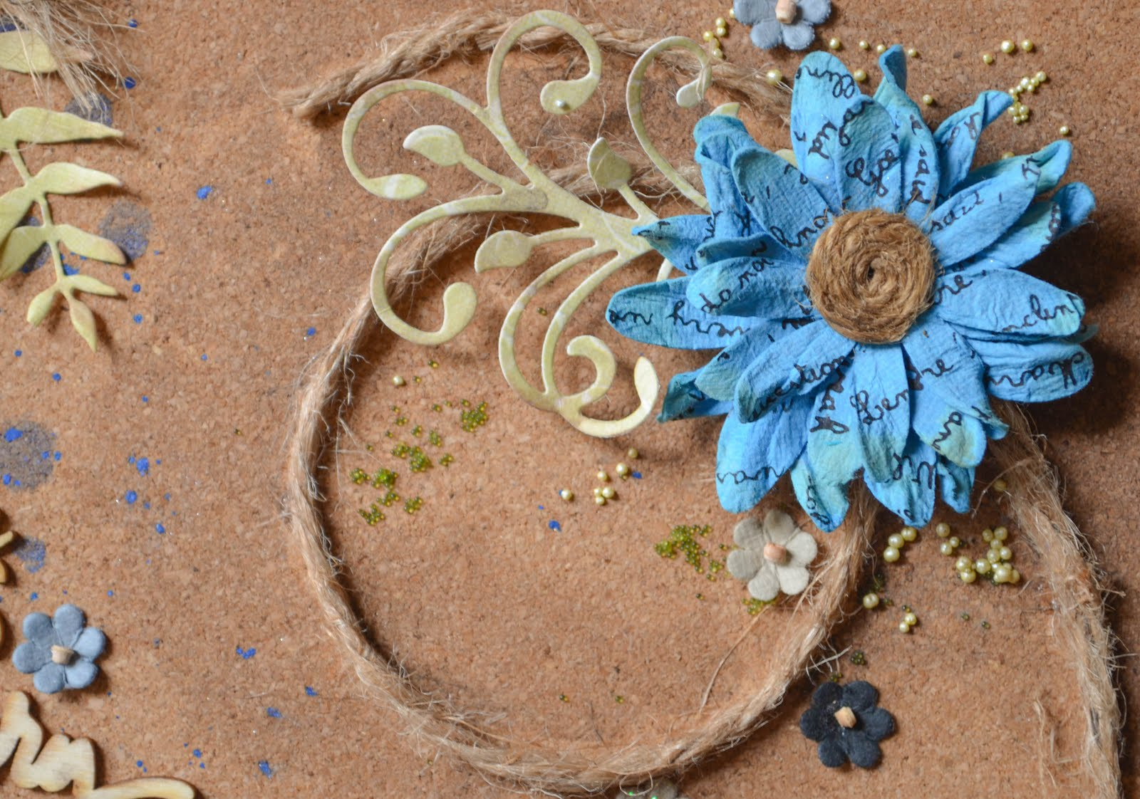 Blue and brown scrapbook layout featuring cork, ruler, die cut leaves, rustic handmade flowers, wood veneers, tiny flowers, acrylic paint, and jute string rope with prills and stenciling