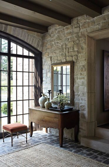 Decor inspiration: Limestone walls and antique console in #Frenchfarmhouse entry on Hello Lovely Studio
