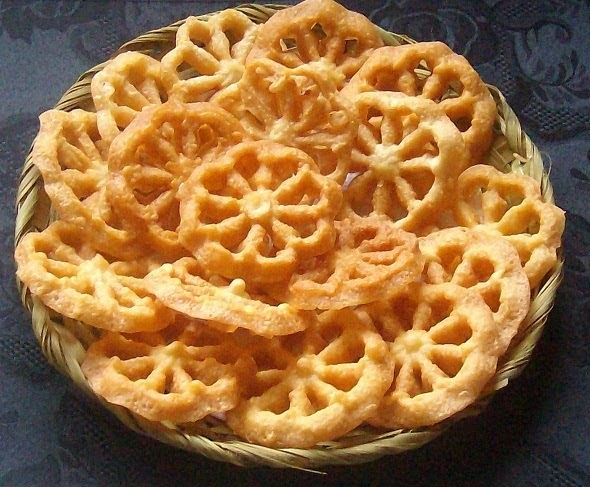 we love our pithas are a part of food tradition and  sanjer pitha