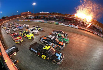 The field does a four-wide military salute prior to the start of the NASCAR Camping World Truck Series Eldora Dirt Derby at Eldora Speedway on July 18, 2018 in Rossburg, Ohio.