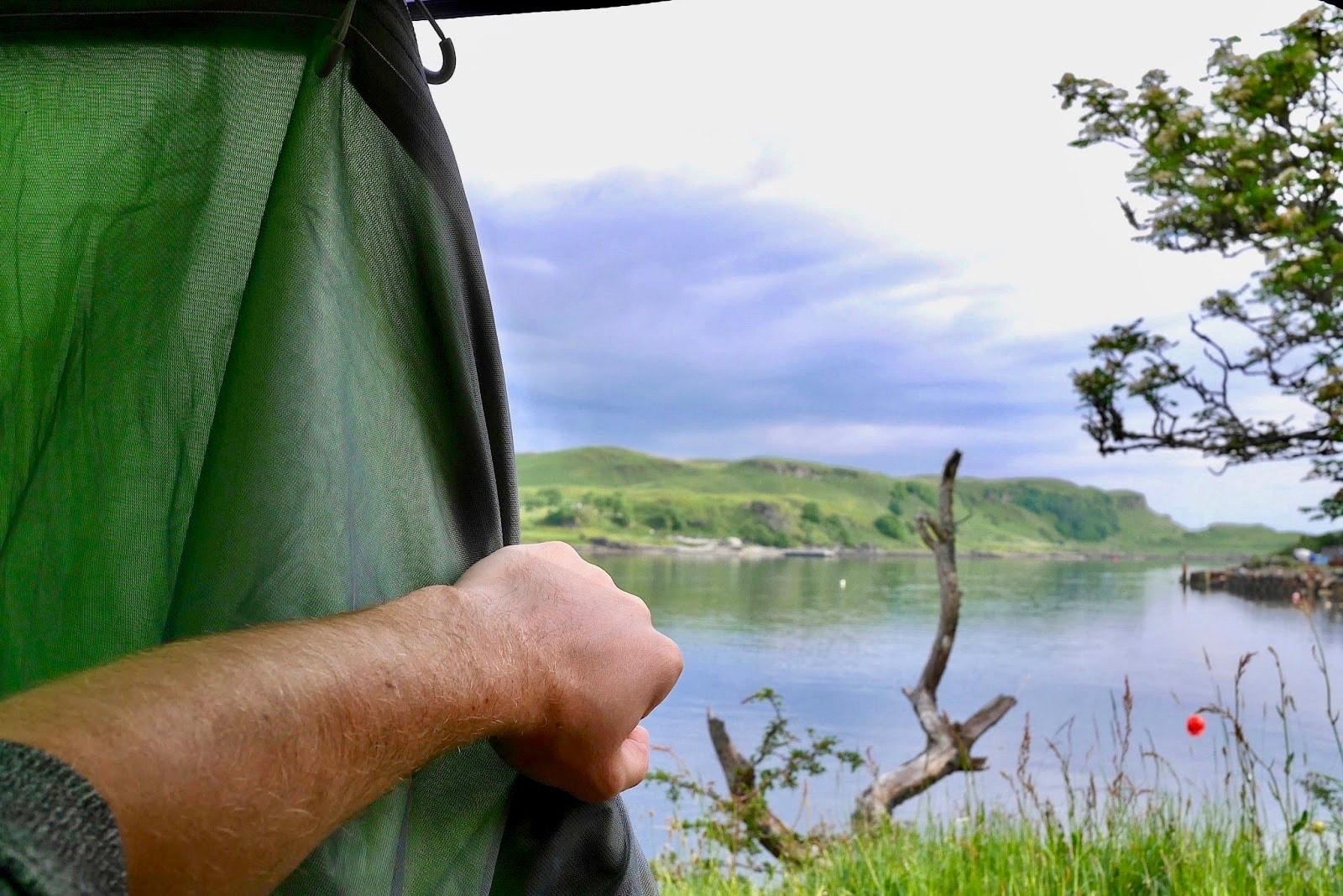 Opening my tent to show the beautiful view of the loch, www.CalMCTravels.com, The best campsites in Scotland