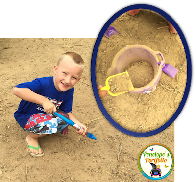 A boy playing in the dirt/sand with toys while camping