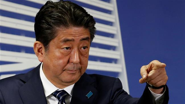 Japan's Prime Minister Shinzo Abe vows to 'deal firmly' with North Korea immediately after he won elections