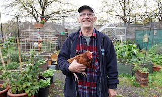 a man holding a chicken