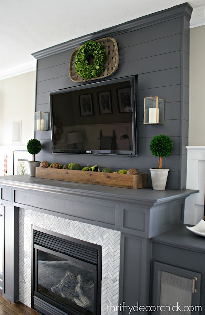 Gray fireplace with marble surround