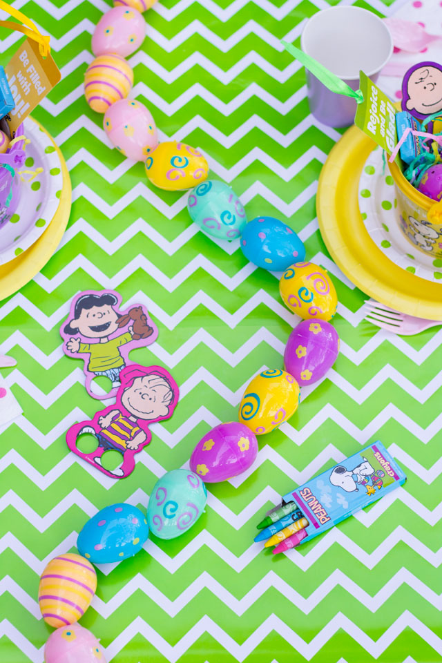 Make a simple DIY Easter table runner with plastic Easter eggs!