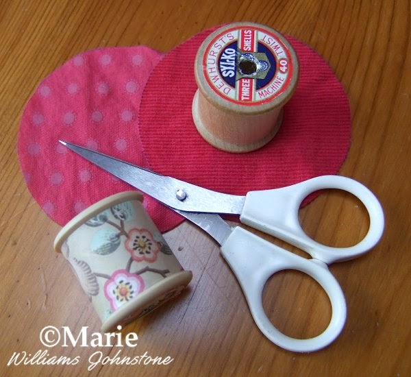 Pointed sharp embroidery scissors, spools and fabric