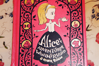 cover of a leatherbound cover of alice's adventures in wonderland