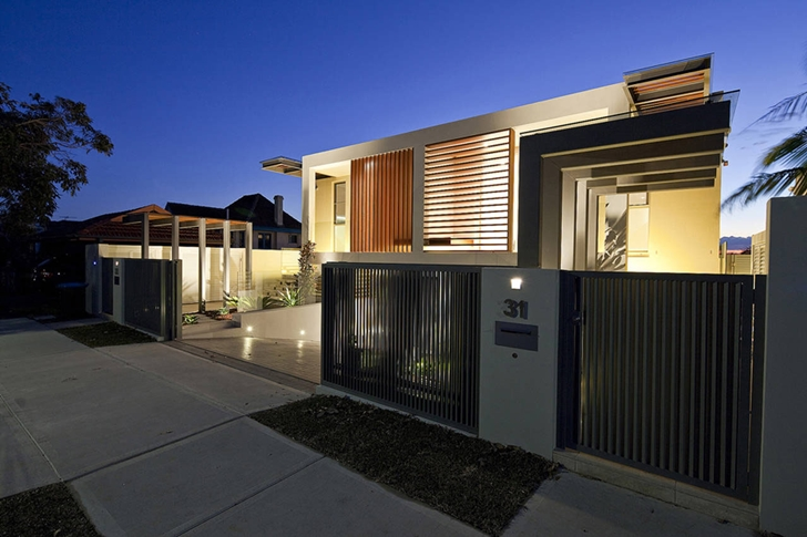 Street facade of Portland Street Duplex by MPR Design Group at night