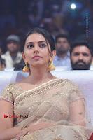 Actress Rakul Preet Singh Stills in Golden Embroidery saree at Rarandoi Veduka Chuddam Audio Launch .COM 0016.jpg