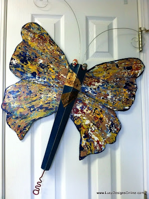 recycled table leg butterfly art with license plates