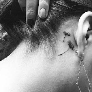tatuaje oreja diente de leon