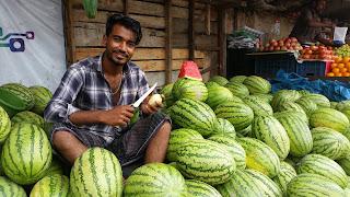 Korail Basti sitting surrounded by the produce