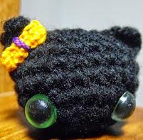 http://www.ravelry.com/patterns/library/tiny-black-cat-2