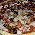 بيتزا بالفلافل والدنجال والمودزريلا