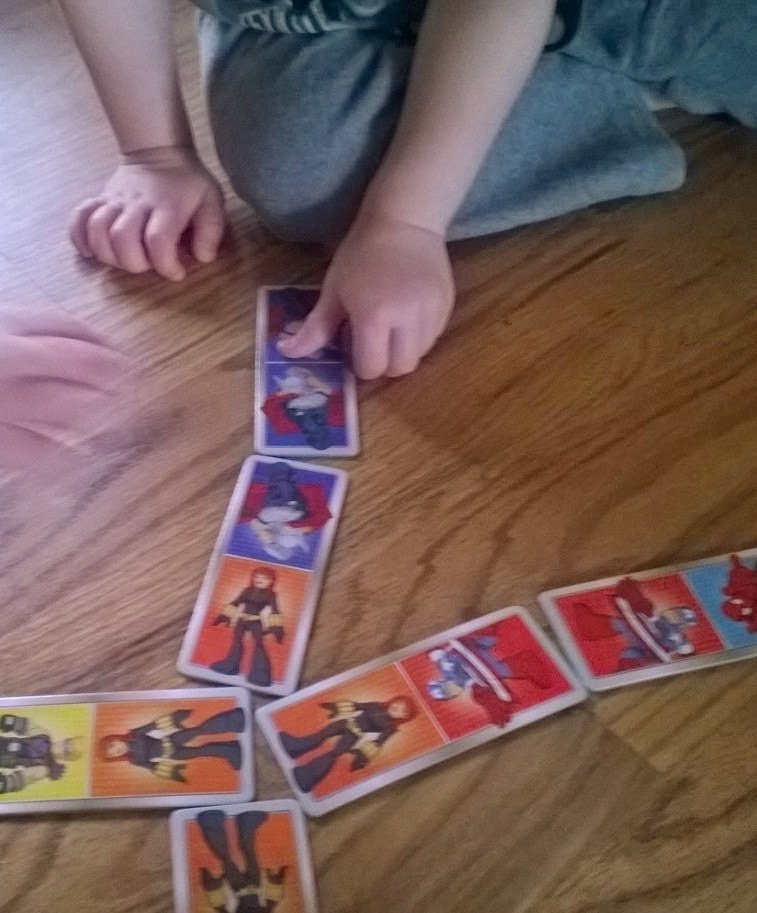 Playing dominoes with toddlers.