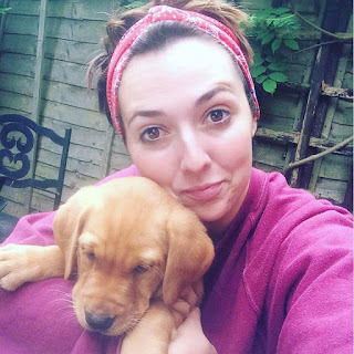 Georgina Bishopp with a puppy
