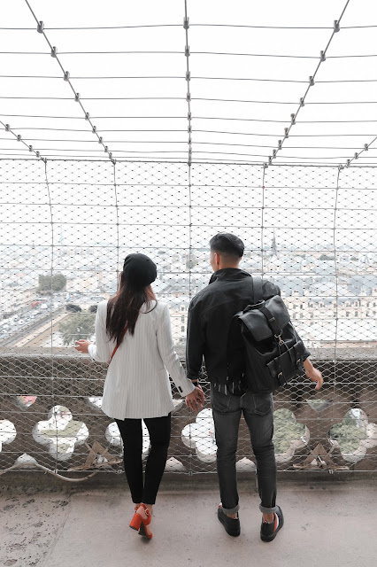 Couple overlooking the view from the Top of Notre Dame | Tips and Tricks