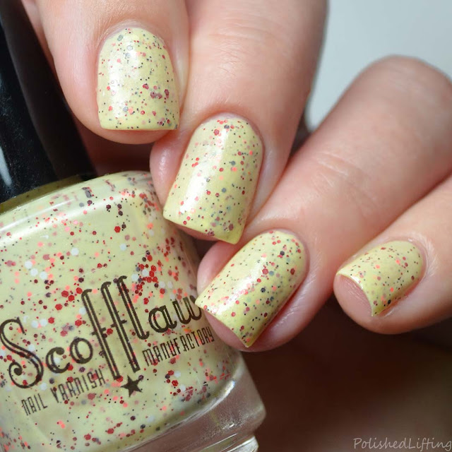 yellow crelly nail polish with red glitter
