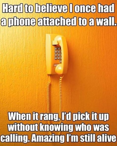 a phone attached to a wall