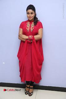 Actress Poorna Latest Stills in Red Dress at Rakshasi First Look Launch  0320.JPG