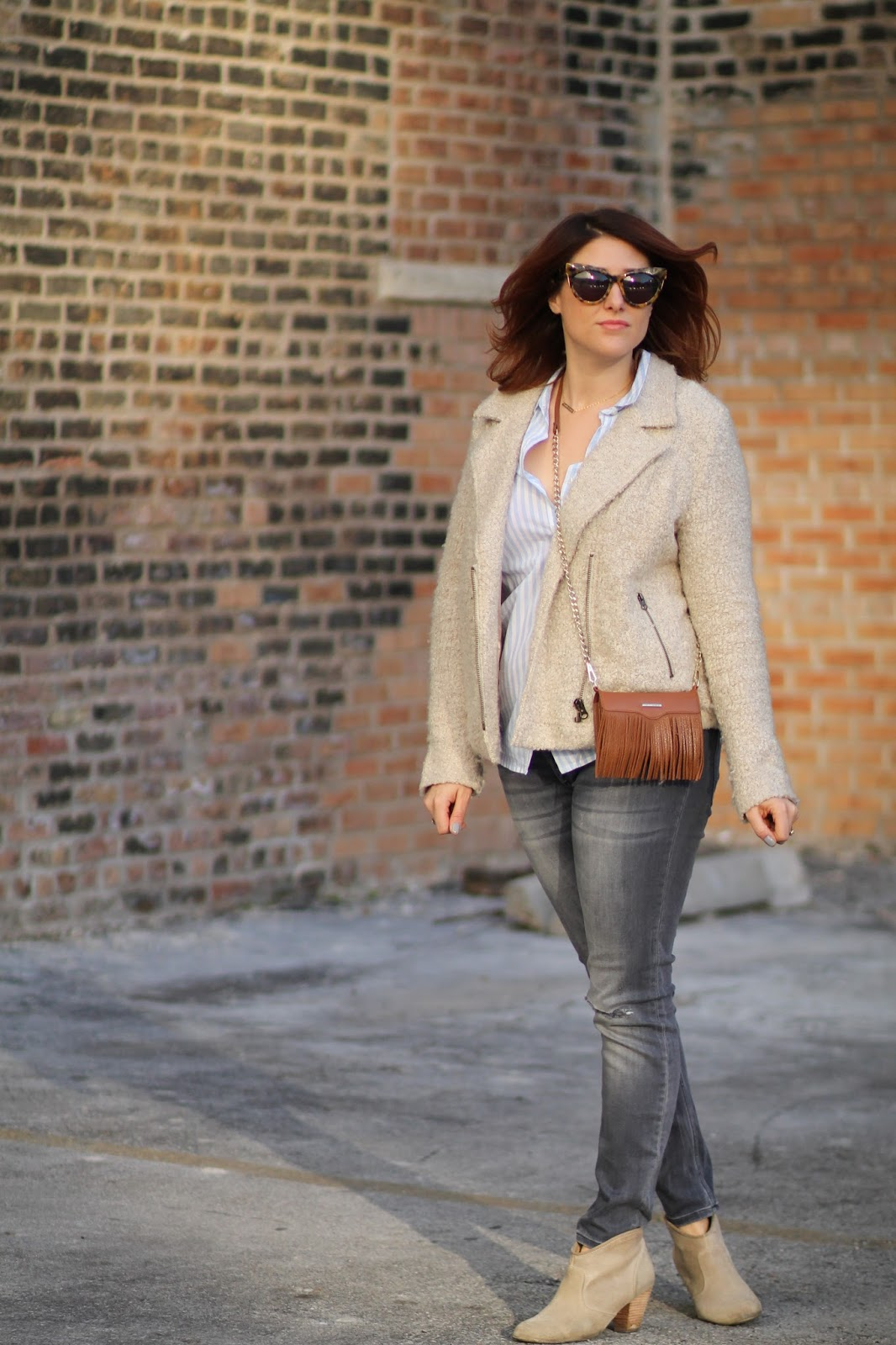 casual outfit idea, brunch look, weekend outfit, button down shirt, moto jacket, fringe bag purse, suede booties and distressed ripped gray jeans, Rebecca Minkoff fringe phone case