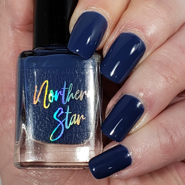 Dark Dusty blue nail polish in a glossy creme finish