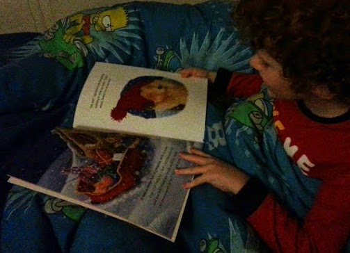 6 year old reading christmas story book