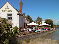 ship inn langstone umbrellas in pub garden