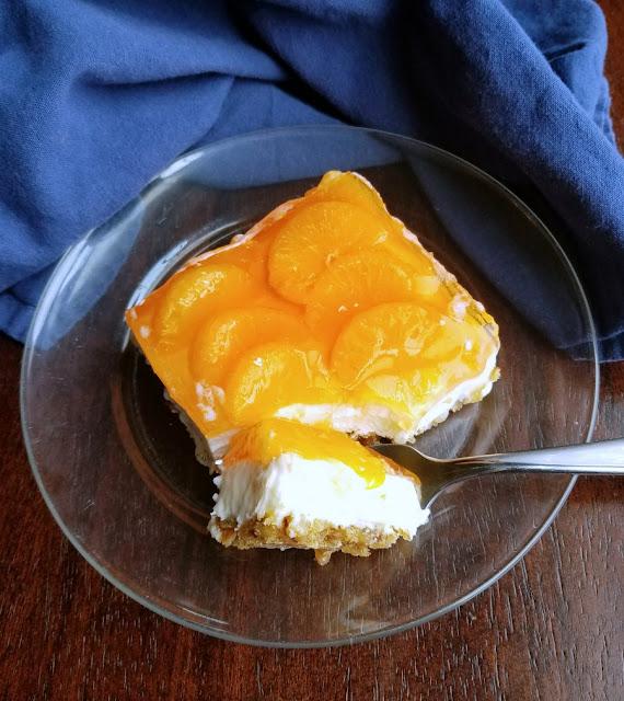 piece of creamy orange pretzel salad with fork