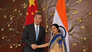 External Affairs Minister Sushma Swaraj with her  Chinese counterpart Wang Yi in New Delhi