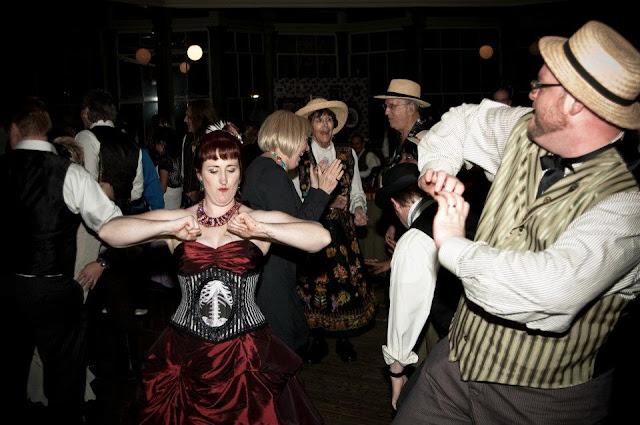 steampunk wedding, steampunk bride and groom, louise black corset, galveston, wedding, garten verein, steampunk wedding reception, red wedding dress