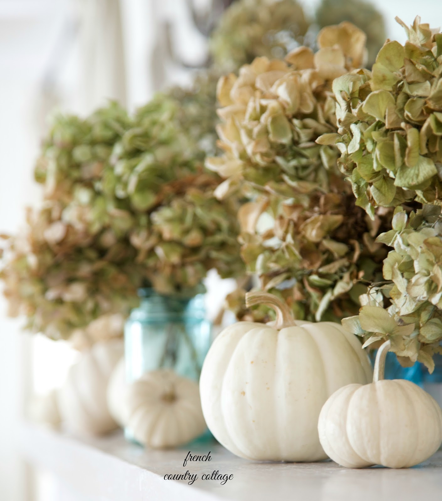 Easy Autumn Decorating Blue Jars On The Mantel