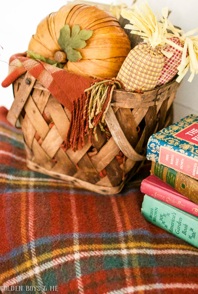 Basket with plaid blanket, pumpkins and old books as fall decor -www.goldenboysandme.com