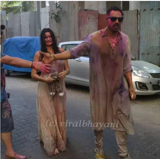 arjun rampal with girlfriend on holi