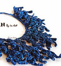 http://www.ravelry.com/patterns/library/coral-reef-necklace---crochet-pdf-pattern