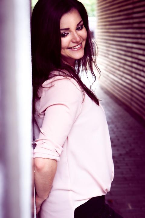 smiling brunette side view.jpeg