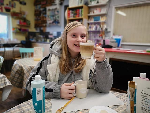 Tween enjoying a coffee