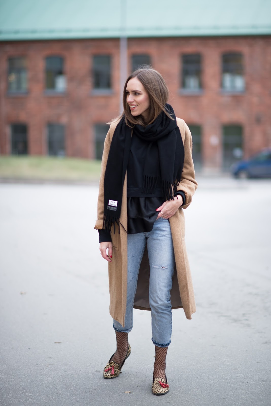 camel coat black scarf outfit