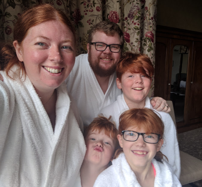 10 Reasons to Stay at Matfen Hall in Northumberland with Kids  - family in robes ready for spa day