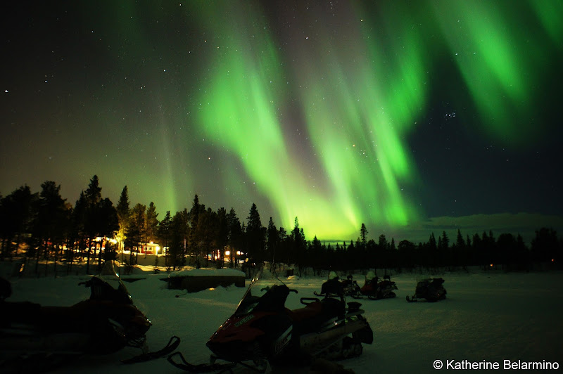 Snowmobiles Under Northern Lights Outdoor Winter Activities in Sweden's Lapland