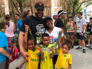 a family poses with their medal during race